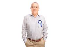 Proud senior posing with blue award ribbon Stock Images