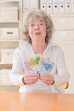 Proud senior woman with banknotes Stock Image