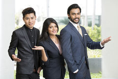 Proud smiling business people gesturing Stock Photos