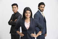 Proud smiling business people. Standing on white background Royalty Free Stock Image