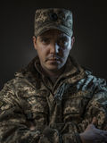 Proud soldier boy portrait in the dark Royalty Free Stock Photos