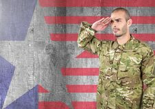 Proud soldier saluting against american flag background Royalty Free Stock Images