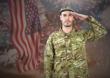 Proud soldier saluting against fluttering american flag and fireworks in background. Digital composite of Proud soldier saluting against fluttering american flag Royalty Free Stock Photos
