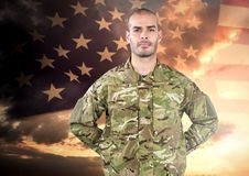 Proud soldier standing on american flag background Stock Images