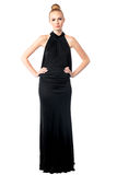 Proud sophisticated woman with attitude. Proud sophisticated beautiful woman in a long black evening gown with attitude standing looking at the camera with a Royalty Free Stock Photos