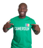 Proud sports fan from Cameroon. Sports fan from Cameroon is proud about his country on an isolated white background for cutout Stock Images