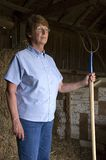 The Proud and Stoic Farmer Wife Standing in Barn royalty free stock images