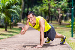 Proud and successful man doing sport push-up Stock Photography