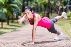 Proud and successful woman doing sport push-up Royalty Free Stock Photo