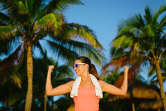 Proud sucessful fitness woman showing biceps Stock Images