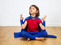 Free Proud Superhero Child Practicing Yoga And Meditation For Zen Humour Royalty Free Stock Images - 162043439