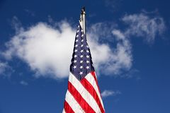 Flag of the United States of America. Proud symbol of the United States of America, stars and stripes. Freedom colors of red, white and blue. Brilliant blue sky Royalty Free Stock Photo
