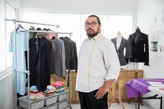 Proud tailor in his office Stock Photos