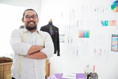 Proud tailor in his office. Portrait of proud tailor in his office looking at camera Stock Images