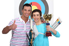 Proud team of archers stock photos
