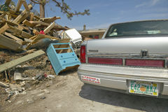 Proud to be an American bumper sticker and debris in front of house heavily hit by Hurricane Ivan in Pensacola Florida Royalty Free Stock Photography