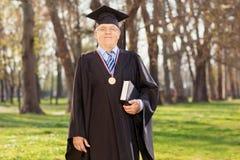 Proud university dean posing in a park Stock Photos