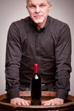Proud wine maker man with a bottle Royalty Free Stock Image