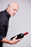 Proud wine maker man with a bottle Stock Photography