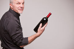 Proud wine maker man with a bottle Royalty Free Stock Images