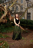 Proud woman in Victorian outfit in the park Royalty Free Stock Images