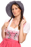Proud woman, wearing a rustic hat and a dirndl Stock Image