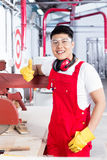 Proud worker at his workplace in industrial plant Stock Photography