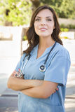 Proud Young Adult Woman Doctor or Nurse Portrait Outside. Proud Attractive Young Adult Woman Doctor or Nurse Portrait Outside Stock Photography