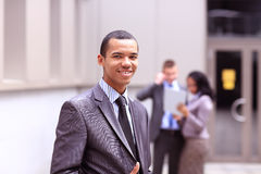 Proud young African business entrepreneur smiling. In a city Royalty Free Stock Images