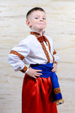 Proud young boy in a colorful costume Royalty Free Stock Photos