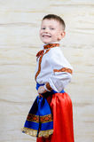 Proud young boy in a colorful costume Stock Photo