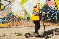Proud young boy with his scooter Royalty Free Stock Image
