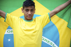 Proud Young Brazilian Football Fan Holds Brazilian Flag Stock Images
