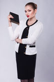 Proud Young Business Woman in Modern Costume with Book. Strict Woman in Modern Costume with Book Royalty Free Stock Photos