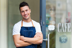 Proud young cafe owner in doorway Royalty Free Stock Photography