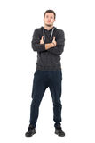 Proud young cool man in comfortable sportive clothing with crossed hands. Full body length portrait over white studio background Stock Photos