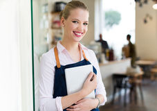 Proud young female cafe owner Royalty Free Stock Photo