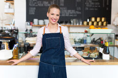 Proud young female cafe owner Stock Photos