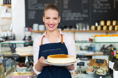 Proud young female cafe owner Royalty Free Stock Image