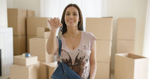 Proud young woman holding up a set of house keys Royalty Free Stock Photo