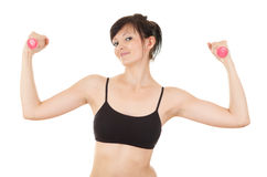 Proud young woman with small dumbbells Stock Image