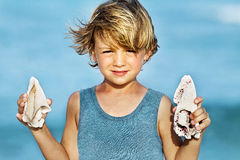 Proudly  boy showing his shells in Mexico Stock Image