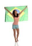 Proudly Brazilian. Beautiful Latin Raising Brazilian Flag Stock Images