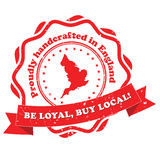 Proudly handcrafted in England. Be loyal, buy local - grunge red label. Print colors used Royalty Free Stock Images