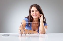 Proudly young woman with a house of cards Royalty Free Stock Image