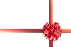 Proue et bandes rouges de cadeau Photographie stock libre de droits