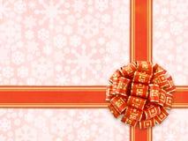Proue rouge de cadeau au-dessus de fond de flocons de neige Images libres de droits