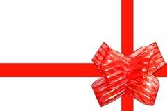 Proue rouge de cadeau avec des bandes Photos libres de droits