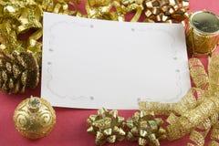 Proues de carte et d'or de Noël Photographie stock