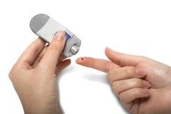 Prova del diabetico della medicina di Glucometer Immagini Stock